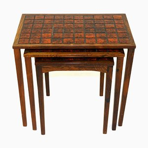 Tavolini ad incastro in palissandro e ceramica, anni '60