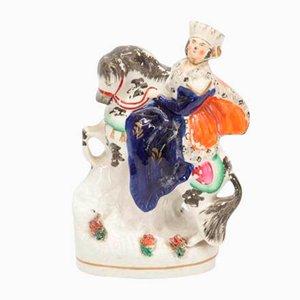 Antike englische Keramik Statue einer Frau, die ein Pferd von Bow reitet