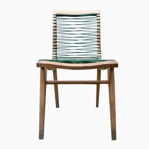 Sedia in quercia e plastica di Louis Sognot