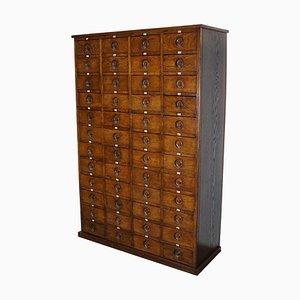 Mueble de apotecario inglés grande de roble, años 20
