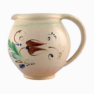 Jug in Glazed Stoneware Flowers on a Cream Colored Background from Kähler HAK