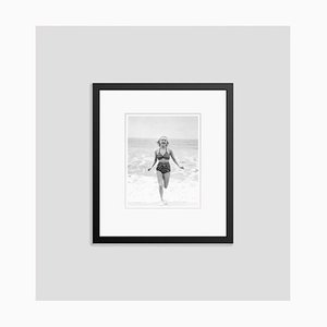 Betty Grable Chasing Waves Archival Pigment Print Framed in Black by Everett Collection