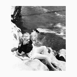 Bette Davis Models Beside a Flowing River Archival Pigment Print Framed in White by Everett Collection
