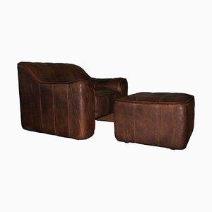 Modell DS44 Sessel und Fußhocker aus Büffelleder von de Sede, 1960er