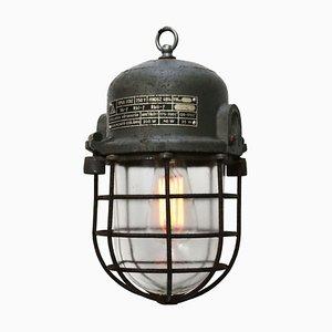 Graue vintage Industrie Lampe aus massivem Glas in Käfigbauweise