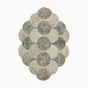 Tappeto rotondo patchwork annodato a mano in lana anatolica beige