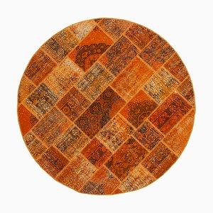 Alfombra anatolia decorativa anaranjada redonda de patchwork anudada a mano