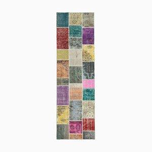 Alfombra anatolia decorativa anónima vintage de patchwork con motivos anudados a mano
