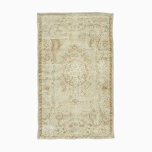 Orientalischer antiker handgeknüpfter Vintage Teppich in Beige