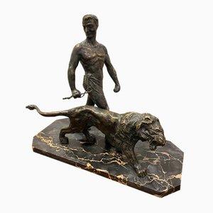 Escultura Art Déco de León y entrenador, bronce
