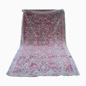 Vintage türkischer Karapinar-Teppich in gedeckten Farben mit Blumenmuster, 1970er Jahre