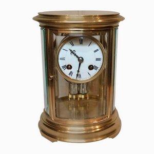 Petite horloge ovale à quatre verres