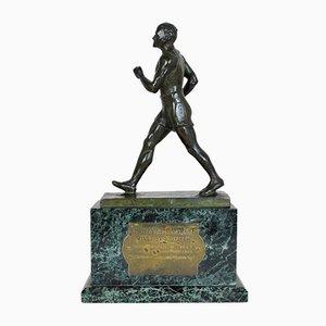 E Fraisse, campeón de carreras de fondo, bronce, siglo XX