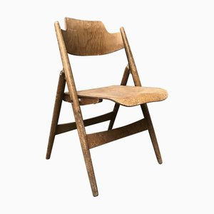 Silla plegable de madera de Egon Eiermann para Wilde + Spieth, años 60