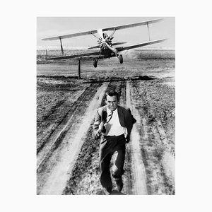 Cary Grant Plane Action Archival Pigment Print Framed in White by Everett Collection
