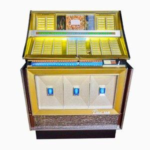 Jukebox Rowe Ami vintage de 1965 con 120 singles