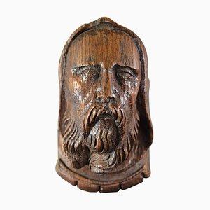 Ménsula de cabeza de hombre barbudo con capucha de roble tallado