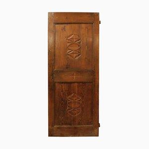 Puerta antigua de madera de alerce y figuras geométricas talladas, Italia, siglo XIX