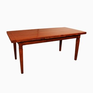 Table extensible antique en bois de cerisier
