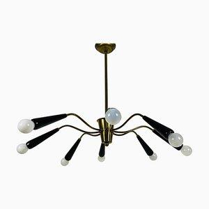Lampadario Sputnik Mid-Century a otto braccia in ottone attribuito a Arredoluce, Italia, anni '50