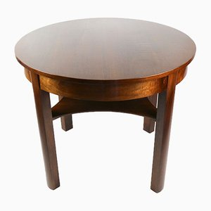 Mesa de cocina redonda marrón brillante, años 70