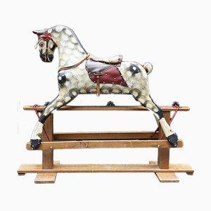 Cheval à bascule en bois antique