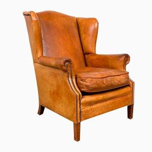 Poltrona alata in pelle di pecora vintage color cognac