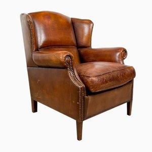 Poltrona alata in pelle di pecora marrone scura vintage