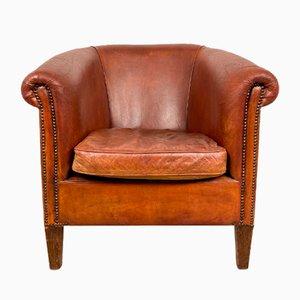 Club chair vintage in pelle di pecora