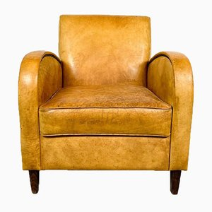 Poltrona vintage in pelle di pecora marrone chiara