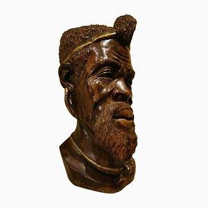Antiker Holzkopf mit Goldverzierung