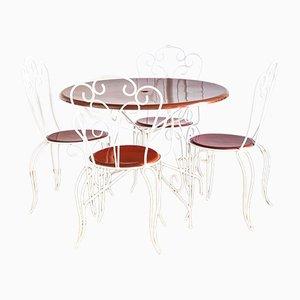 Mesa y sillas de metal y fibra de vidrio, años 70