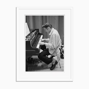 Elvis at the Piano Archival Pigment Print Framed in White by Phillip Harrington