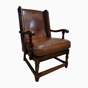 English Cognac Leather & Oak Wingback Armchair from Criterion Cord Chairs & Settees, 1960s