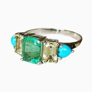 White Gold Ring with an Emerald and Yellow and Turquoise Beryls