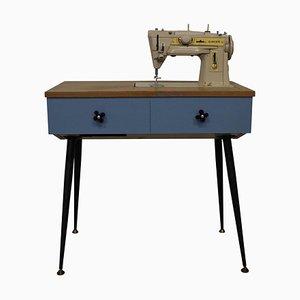 Máquina de coser eléctrica en consola