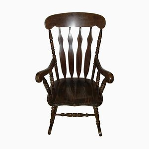 Antique Rocking Chair in Dark Solid Wood