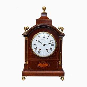 Uhr aus Mahagoni mit Intarsien