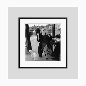 Taylor and Poodle Silver Gelatin Resin Print Framed in Black by Stanley Sherman