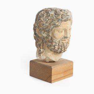 Scultura di testa romana, XVI secolo, in arenaria