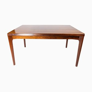 Dining Table in Rosewood with Extensions by Henning Kjærnulf, 1960s
