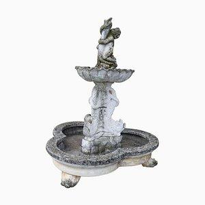 Fuente de jardín neoclásica de piedra con estatua, años 30