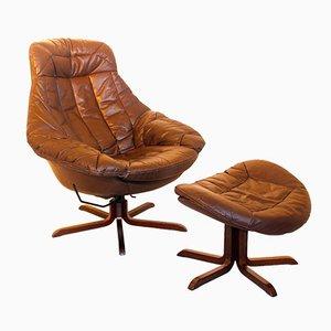 Leder Lounge Sessel mit Fußhocker von H. W. Klein, 1970er