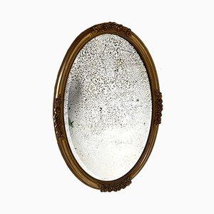 Specchio ovale dorato con piatto a forma di mercurio