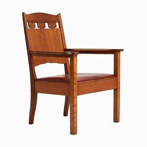 Antiker Armlehnstuhl aus Eiche & Leder