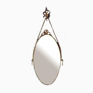 Specchio ovale in ottone con cornice decorativa, Italia, anni '50