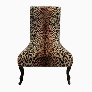 Sillón Napoleon III antiguo con tapicería nueva con estampado de leopardo