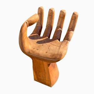 Sedia a forma di mano in legno Suar
