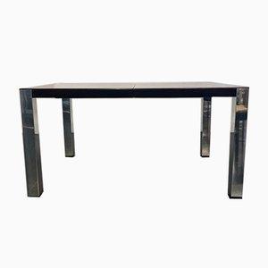 Mesa de comedor de palisandro y acero, años 70