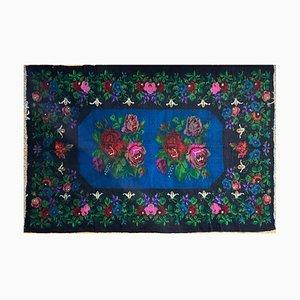 Vintage Blue Rug with Floral Design